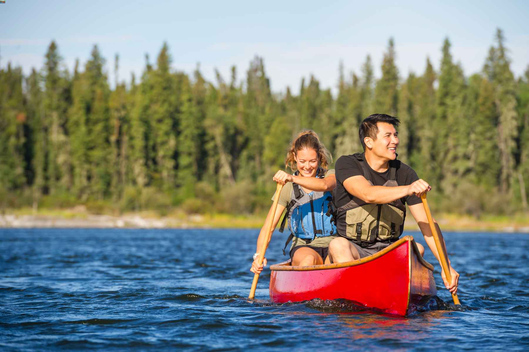 Couple canoeing on a lake at Lac LaRonge Provincial Park in Saskatchewan